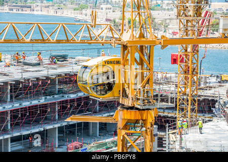 Crains on construction site of building - Stock Photo