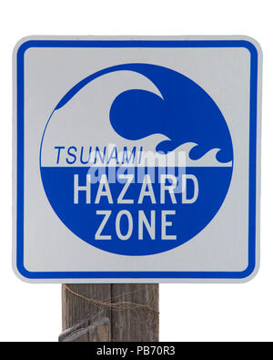 Tsunami Hazard Zone warning sign on an old wood post isolated on white background. - Stock Photo