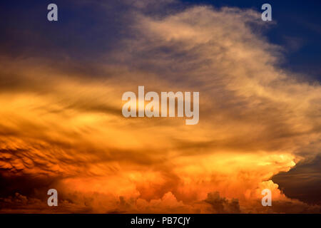 Unusual cloud formation during the sunset sky - Stock Photo