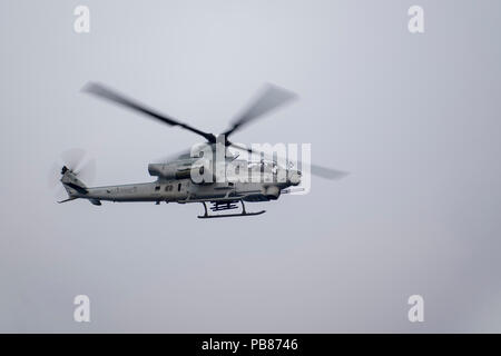 180723-N-VR594-2341 PACIFIC OCEAN (July 23, 2018) An AH-1Z Cobra, assigned to the 'Scarface' of Marine Light Attack Helicopter Squadron (HMLA) 367, departs the flight deck of the Royal Australian Navy landing helicopter dock ship HMAS Adelaide (L01) during the Rim of the Pacific (RIMPAC) exercise, July 23. This is the first time Adelaide has conducted flight operations with Marine AH-1Z Cobras. Twenty-five nations, 46 ships, five submarines, and about 200 aircraft and 25,000 personnel are participating in RIMPAC from June 27 to Aug. 2 in and around the Hawaiian Islands and Southern California. - Stock Photo