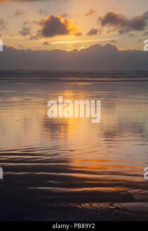 Sunset over Ninety Mile Beach, Northland, New Zealand. - Stock Photo