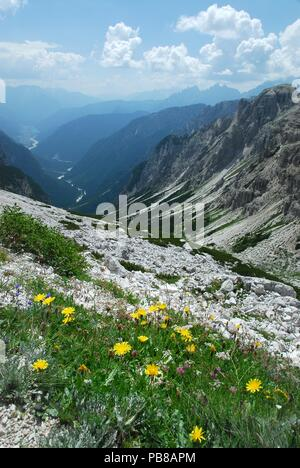 Val Marzon with Auronzo di Cadore in the background view from the path around the 3 Cime of Lavaredo, Dolomites of Sesto, Italy. - Stock Photo
