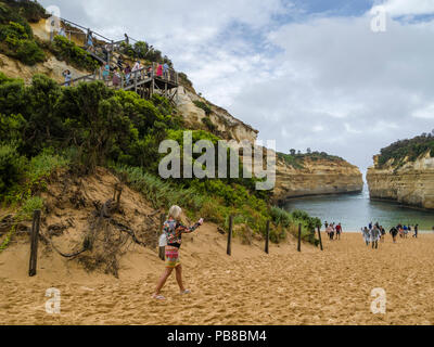 Visitors at beach of Loch Ard Gorge, Port Campbell National Park, Great Ocean Road, Victoria, Australia - Stock Photo