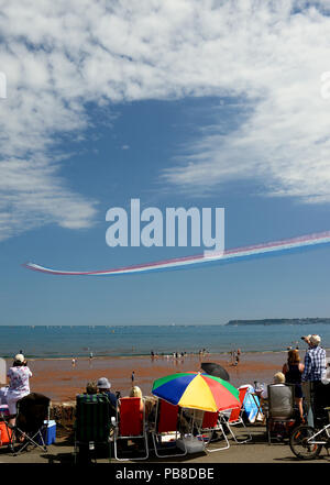Spectators watching the RAF Red Arrows performing at the Torbay Airshow 2018. - Stock Photo