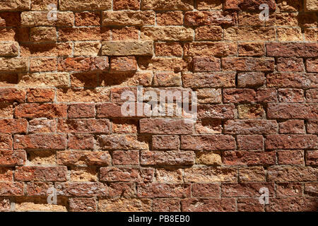 Old broken brick wall texture background, sunlight - Stock Photo