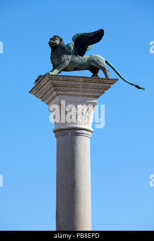 Winged Lion statue, symbol of Venice, clear blue sky in Italy - Stock Photo