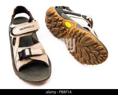 A pair of used unisex suede leather Merrell hiking sandals Kahuna lll with vibram sole isolated cut out on a white background. England UK Britain - Stock Photo