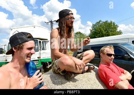 Usti Nad Labem, Czech Republic. 27th July, 2018. Participants of unannounced music event in protected landscape area, near Chuderov, Usti Nad Labem, Czech Republic, left the area on July 27, 2018, under observation of the Czech state police. Credit: Ondrej Hajek/CTK Photo/Alamy Live News - Stock Photo