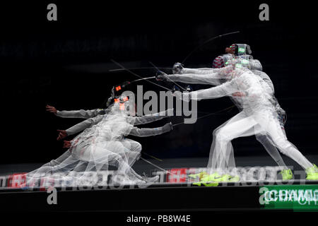 Wuxi, China's Jiangsu Province. 27th July, 2018. This multi-exposed picture shows Daniele Garozzo (L) of Italy fighting against Miles Chamley-Watson of the US during the men's foil team final between Italy and the United States at the Fencing World Championships in Wuxi, east China's Jiangsu Province, July 27, 2018. Italy beat US 45-34 and claimed the title of the event. Credit: Li Bo/Xinhua/Alamy Live News - Stock Photo