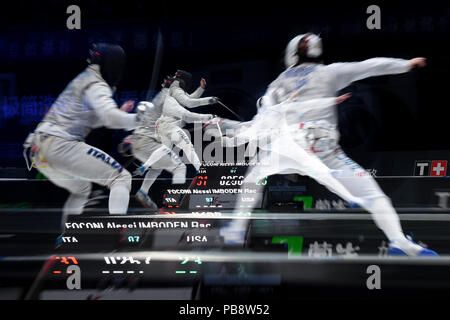 Wuxi, China's Jiangsu Province. 27th July, 2018. This multi-exposed picture shows Alessio Foconi (L) of Italy fighting against Race Imboden of the US during the men's foil team final between Italy and the United States at the Fencing World Championships in Wuxi, east China's Jiangsu Province, July 27, 2018. Italy beat US 45-34 and claimed the title of the event. Credit: Li Bo/Xinhua/Alamy Live News - Stock Photo