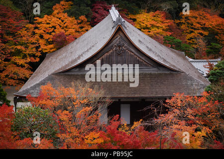 Roof with wooden shingles of a hall building at Nanzen-ji Buddhist temple complex in colorful autumn scenery, traditional Japanese architecture detail - Stock Photo