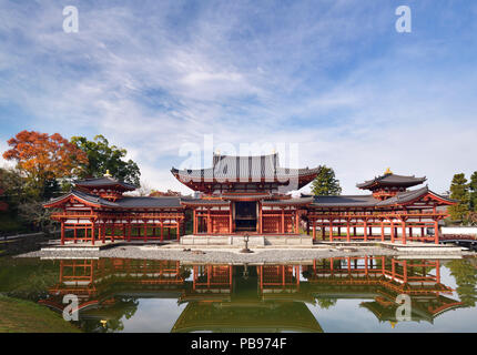 Beautiful Phoenix Hall, Amida hall of Byodoin temple front view, standing under blue sky on Kojima island of Jodoshiki Teien garden pond on a bright s - Stock Photo