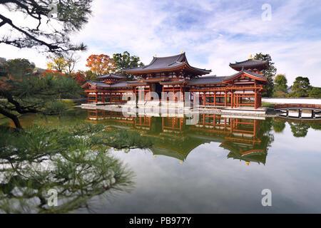 Amida hall, Phoenix hall, Hoodo of Byodo-in temple on the pond of Jodo-shiki Pure Land garden on a bright sunny morning. Uji, Kyoto Prefecture, Japan  - Stock Photo