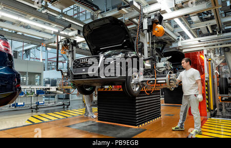 Installation of the wheels on the assembly line for Audi Q2 at the Audi AG plant in Ingolstadt, Bavaria, Germany - Stock Photo