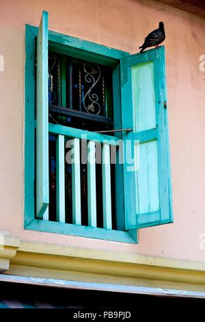 Perspective view of vintage window with open green antique wooden shutters as architectural background with space for copy. - Stock Photo
