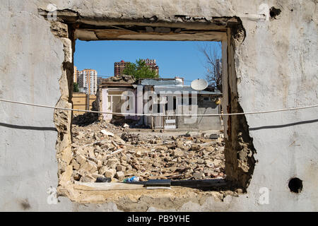 Demolition of an old residential neighbourhood in the city centre of Baku, Azerbaijan to make space for a construction of new bulidings. - Stock Photo