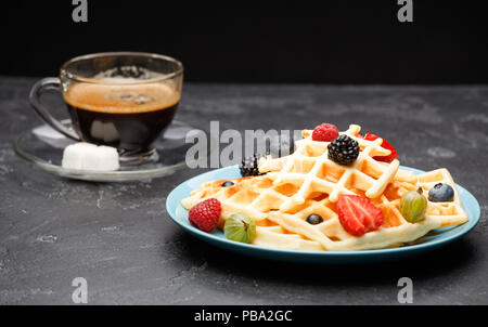Photo of cup of coffee with Belgian wafers with strawberries, raspberries - Stock Photo