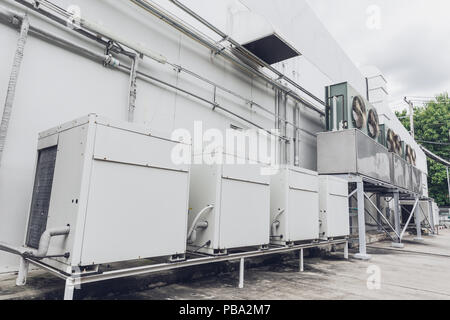 Outdoor row of Compressor HVAC Chiller Fan coil unit (FCU) of Air conditioning. - Stock Photo