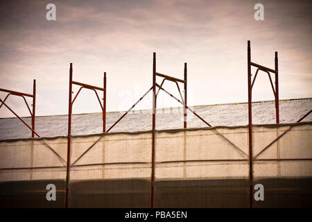Metal scaffolding for the restoration of a building facade - toned image - Stock Photo