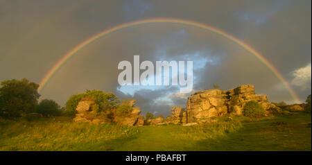 Rainbow over Brimham rocks, Nidderdale area of North Yorkshire, England, UK. August 2015. - Stock Photo