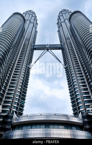 low view point of the petronus twin towers, Kuala Lumpur, two 451 meters high, 88 floors, towers are glass and metal structure, connecting the two tow