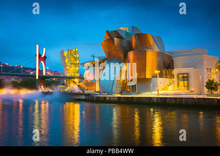 Bilbao cityscape, view at night across the river towards the illuminated Guggenheim Museum and the Puente de la Salve in the center of Bilbao, Spain. - Stock Photo