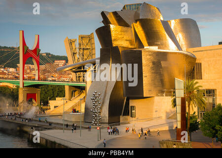 Spain travel city, view at sunset of the Frank Gehry designed Guggenheim Museum in the center of Bilbao, northern Spain.