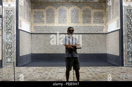 Man posing in front of arabian style interior - Stock Photo