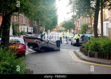 Upside down car after an accident - Stock Photo