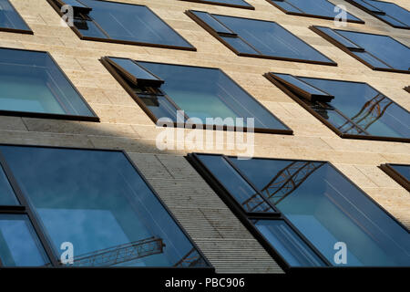 Facade of an office building in the city center of Berlin - Stock Photo