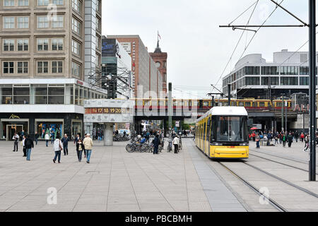 Tram and tourists at Alexanderplatz in Berlin - Stock Photo