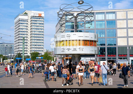 Tourists at the World Clock in Berlin - Stock Photo