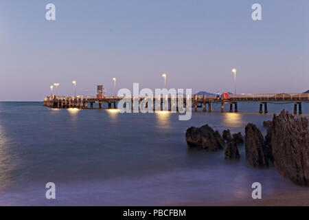 Palm Cove Jetty in quiet of the evening, LE as the sun goes down - Stock Photo