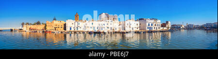 Panoramic view of waterfront with kasbah wall and picturesque houses in old port at sunset. Bizerte, Tunisia, North Africa - Stock Photo
