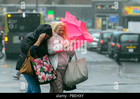 Blackpool, Lancashire, UK Weather. 28/07/2018. Heavy rain and strong winds at the coast with gales forecast for later in the day.  Credit: MediaWorldImages/AlamyLiveNews - Stock Photo