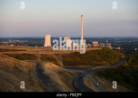 Recklinghausen, Germany. 27th July, 2018. Stargazers have gathered on the Hoheward slagheap to follow the lunar eclipse. During the longest lunar eclipse of the 21st century, the moon dives into the Earth's shadow. Credit: Jana Bauch/dpa/Alamy Live News - Stock Photo