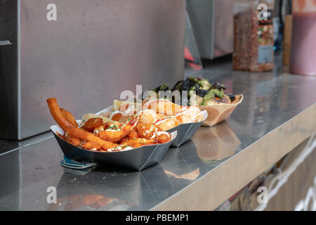 Poole, UK. 28th July 2018. Streetfood options at the Poole Harbour Festival in very windy weather. Credit: Thomas Faull/Alamy Live News - Stock Photo
