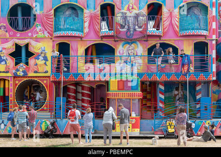 Poole, UK. 28th July 2018. People enjoy the rides, food stalls and live music at the Poole Harbour Festival in very windy weather. Credit: Thomas Faull/Alamy Live News - Stock Photo