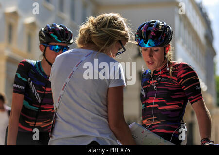 London, UK, 28 July 2018. Prudential RideLondon Classique. Tanja Erath (Canyon SRAM, GER) checks the route ahead of RideLondon Classique - a 65km race around a 5.4km circuit finishing on The Mall. Erath, a former triathlete, joined the team in 2018 after being selected from an online training system Zwift. The race was won by Kirsten Wild (Wiggle-High5, NED). - Stock Photo