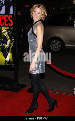 Elizabeth Banks arriving at the Smokin' Aces at the Chinese Theatre In Los Angeles. January 18, 2007.  eye contact smile full length silver metal dress side viewBanksElizabeth044 Red Carpet Event, Vertical, USA, Film Industry, Celebrities,  Photography, Bestof, Arts Culture and Entertainment, Topix Celebrities fashion /  Vertical, Best of, Event in Hollywood Life - California,  Red Carpet and backstage, USA, Film Industry, Celebrities,  movie celebrities, TV celebrities, Music celebrities, Photography, Bestof, Arts Culture and Entertainment,  Topix, vertical, one person,, from the year , 2007, - Stock Photo