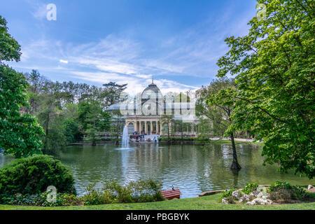 Madrid, Spain - April, 2017 : Crystal Palace (Palacio de Cristal) in Buen Park del Retiro (Parque de El Retiro) in Madrid, Spain. - Stock Photo