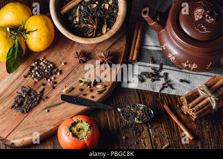 Ingredients for Masala Chai with Tangerines and Persimmon - Stock Photo