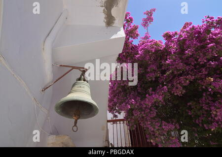 Bell Of The Panagia Tourliani Monastery In Ano Mera On The Island Of Mykonos. Architecture Landscapes Travels Cruises. July 3, 2018. Ano Mera, Island  - Stock Photo