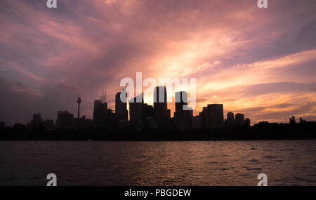 12-01-2018 : Sydney, Australia. Sydney harbour cityscape with silhouette city building at dusk, the most busiest attractive city in Sydney. - Stock Photo