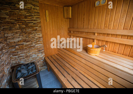 Empty sauna room with traditional sauna accessories - Stock Photo