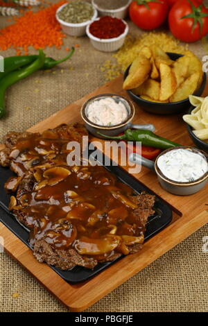 Grilled Beef Meat Steak with Barbeque Sauce - Stock Photo