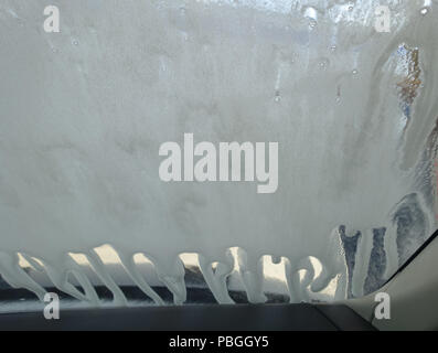 Interior view of car being washed - Stock Photo
