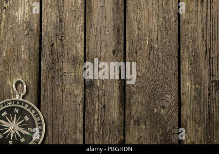 Compass on an old wooden background. Adventure and travel concept. Copy space - Stock Photo