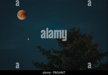 View of Total Lunar Eclipse bloodmoon on July 28 2018 in Germany - Stock Photo