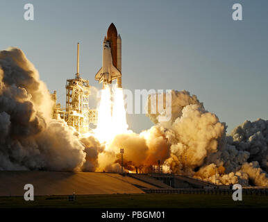 Space Shuttle Atlantis' STS-117 mission launches from the Kennedy Space Center. - Stock Photo